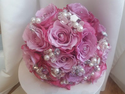 This is an image of a pink rose wedding bouquet with crystals for a wedding brides last minute wedding day