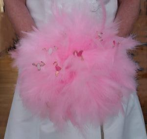 This is an image of a Pink Flamingo feather wedding bouquet for a quirky brides wedding day and keepsake