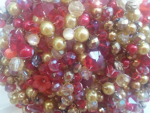 This is a close up image of our Beautiful Red And Gold Crystal Wedding Bouquet