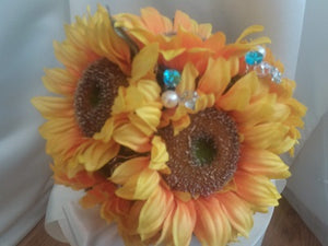 This is an image of the front of a Sunflower and crystal wedding bouquet for a country wedding