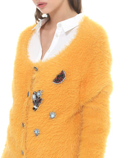 Cardigan with rhinestone button