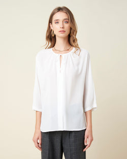 V-neck blouse and bow closure