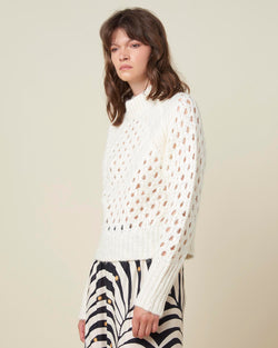 Perforated sweater with laminated knit