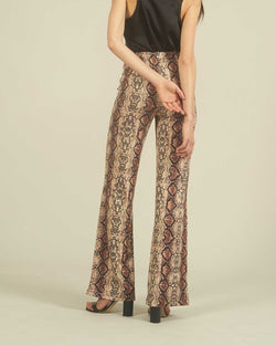 Flared trousers with python pattern
