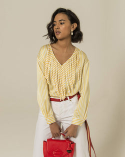 Blouse with fringes on the neckline