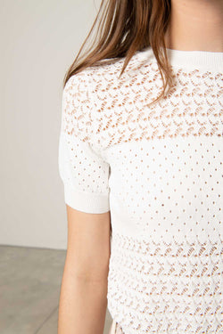 Sweater with embroidered weft