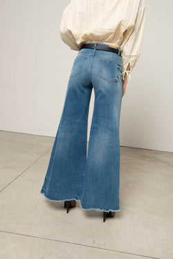 Flared jeans with fringed bottom