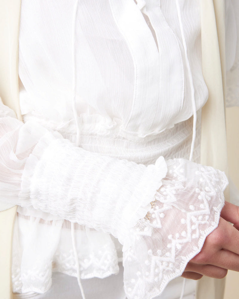 Shirt with ruffles sleeves
