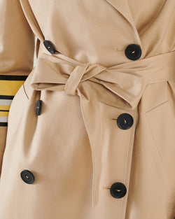 Trench coat with edge with volant