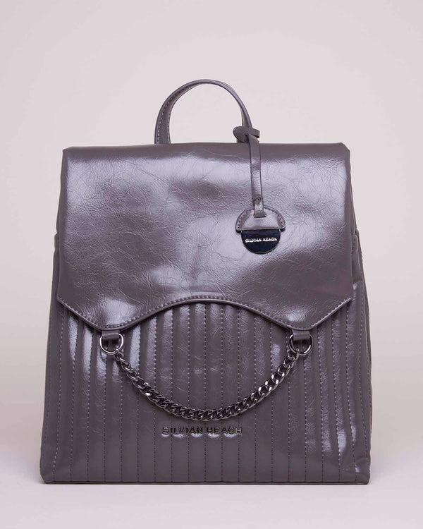 Backpack chained flap