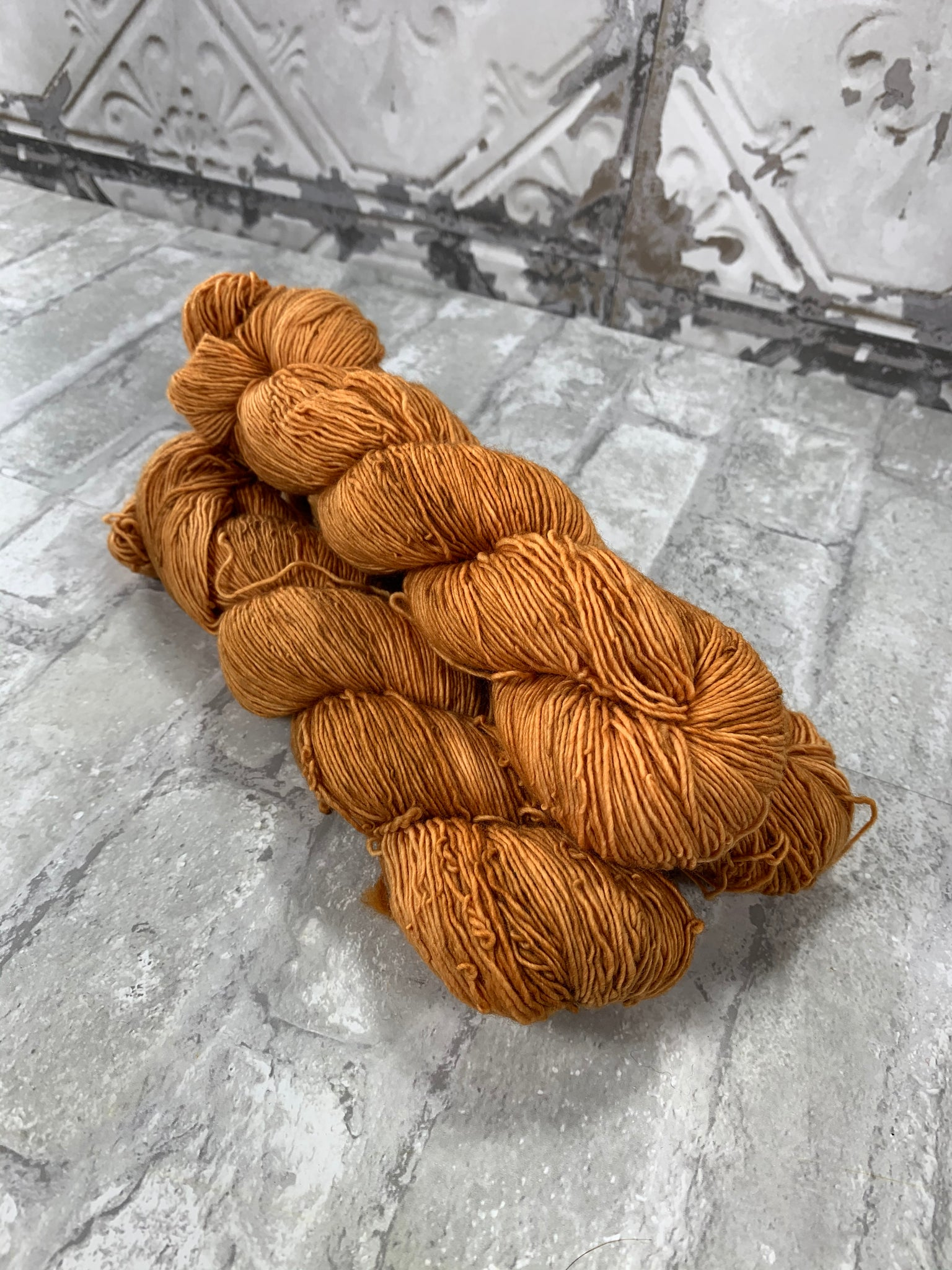 Pumpkin Juice on Slinky a single ply yarn
