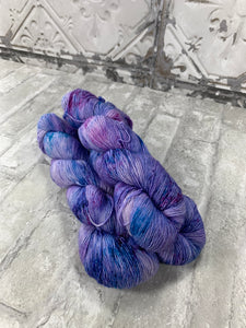 Mystery Purple on Slinky a single ply yarn