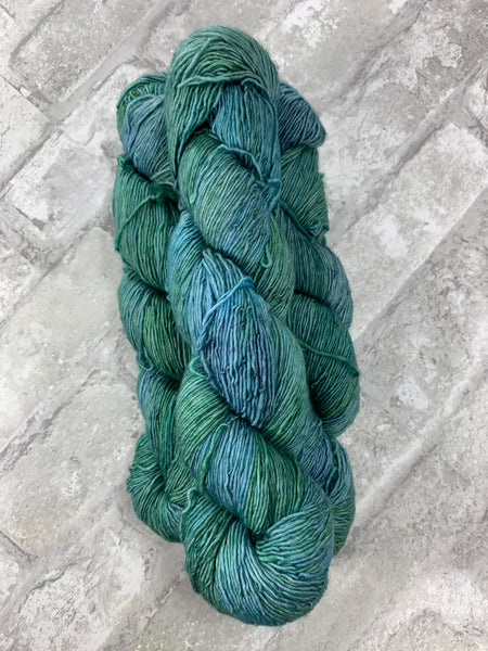 Chelsea's Blue on Slinky a single ply yarn
