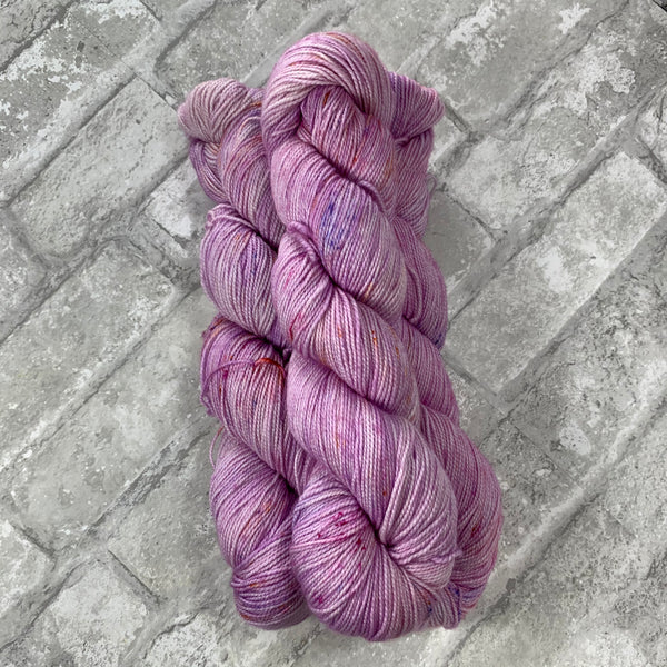 Dainty Lady on Gold 400 yards of super wash fingering weight yarn