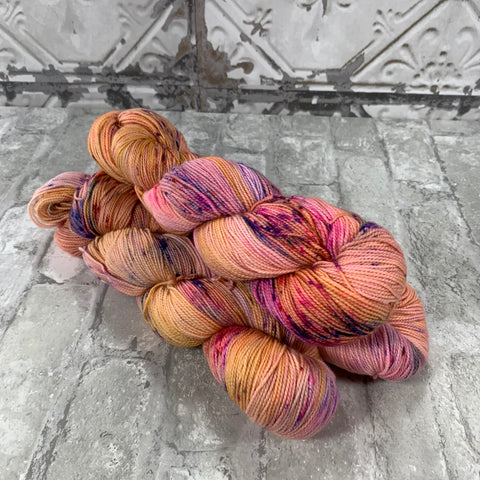 Kiss For Luck on Gold 400 yards of super wash fingering weight yarn