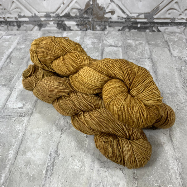 Bronzed on Gold 400 yards of super wash fingering weight yarn
