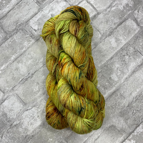 Autumnal on Gold 400 yards of super wash fingering weight yarn