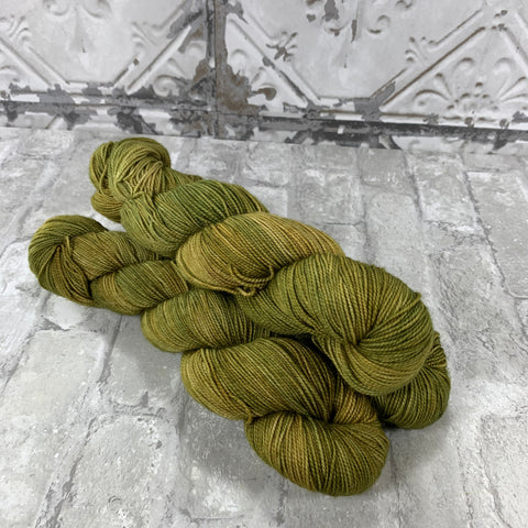 Olive You A Little on Gold 400 yards of super wash fingering weight yarn