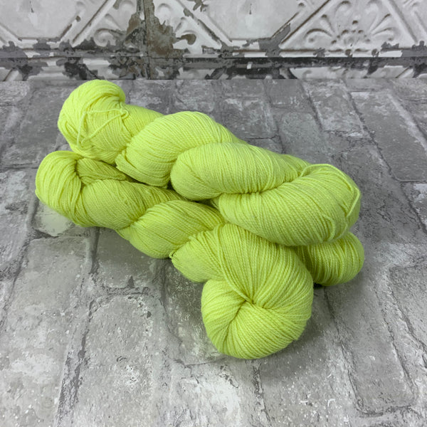 Edison Bulb on Gold 400 yards of super wash fingering weight yarn