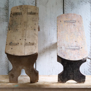 Two small wooden seats