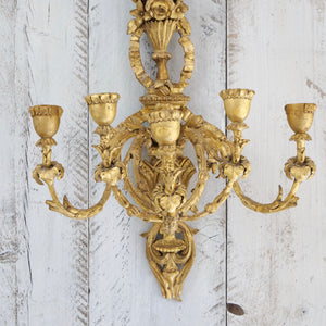 A pair of carved giltwood composition 5 light wall appliqués