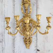 Load image into Gallery viewer, A pair of carved giltwood composition 5 light wall appliqués