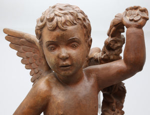 Terracotta sculpture of a cherub by Joaquim Ros
