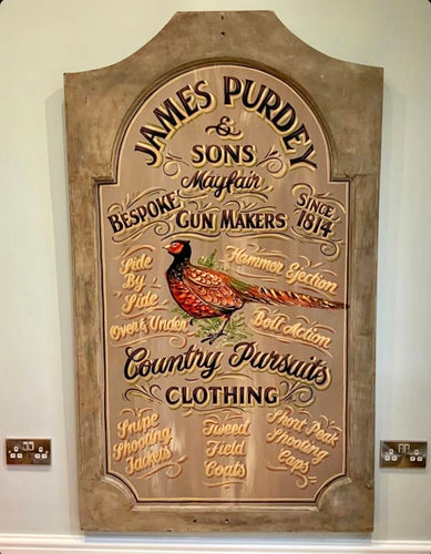 Purdey and Sons painted sign