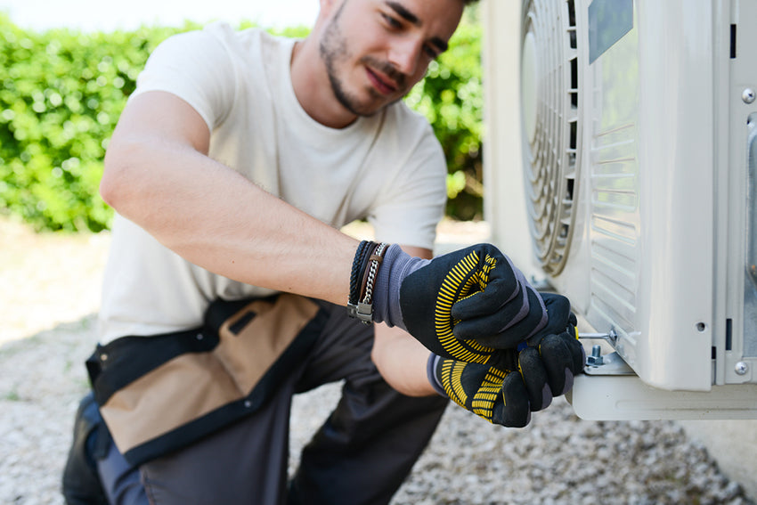a technician installing an air conditioning unit