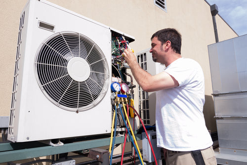 hvac technician working on mini split