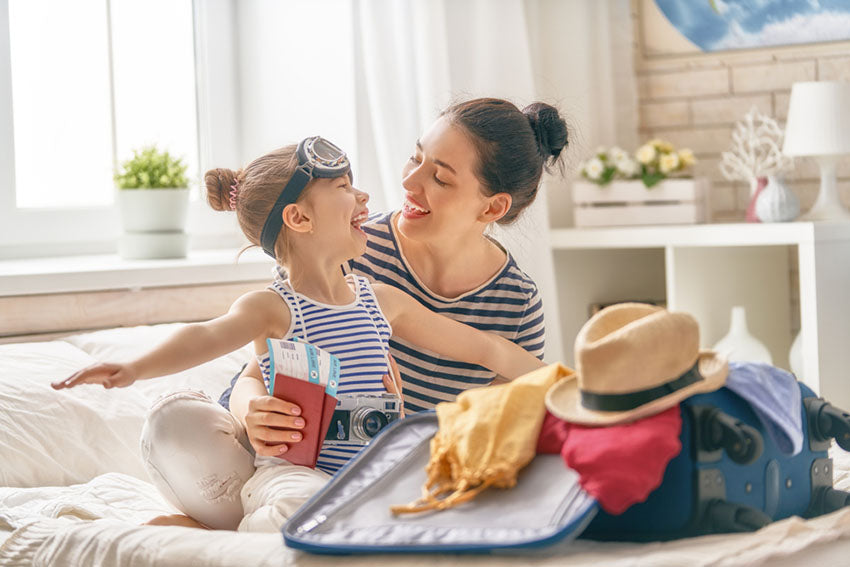 mom daughter laugh together vacation