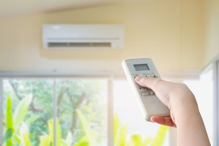 remote pointing at air conditioner