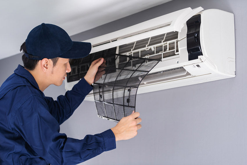 technician service removing air filter