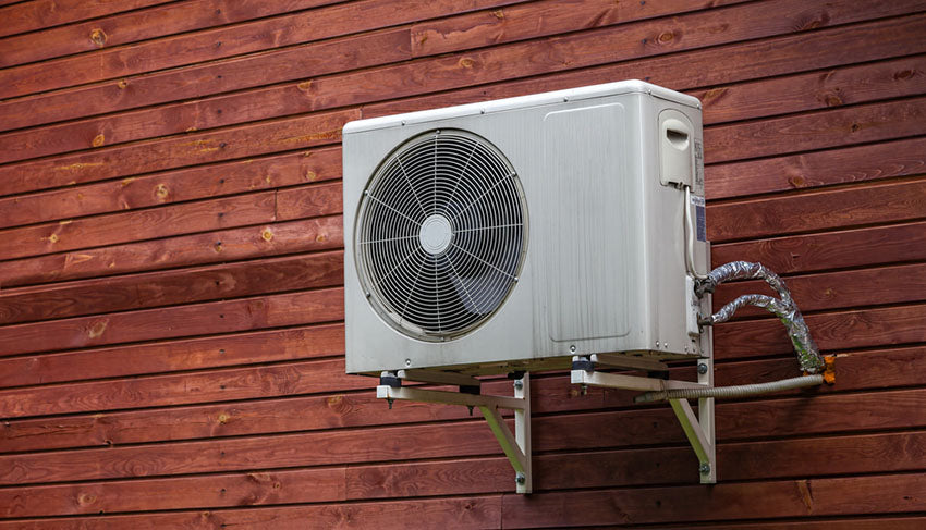 a wall mounted outdoor a/c unit
