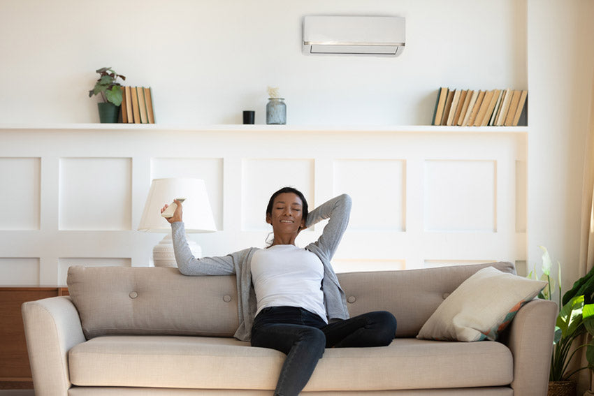 woman relaxing under ductless ac