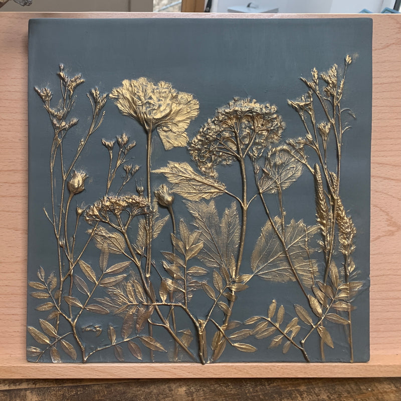 Botanical Dark Grey and Gold Botanical Cast 30cmx30cm with hooks in the reverse for hanging or can be propped on a shelf