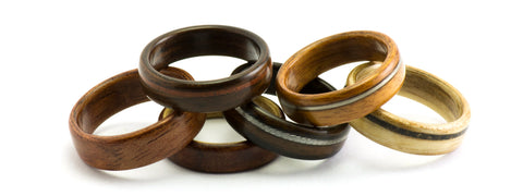 A stack of wood wedding rings by Ebeniste Wood Rings.