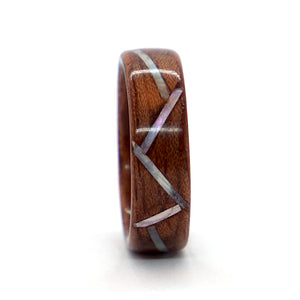 A bubinga bentwood ring accentuated with a series of mother of pearl stripes.