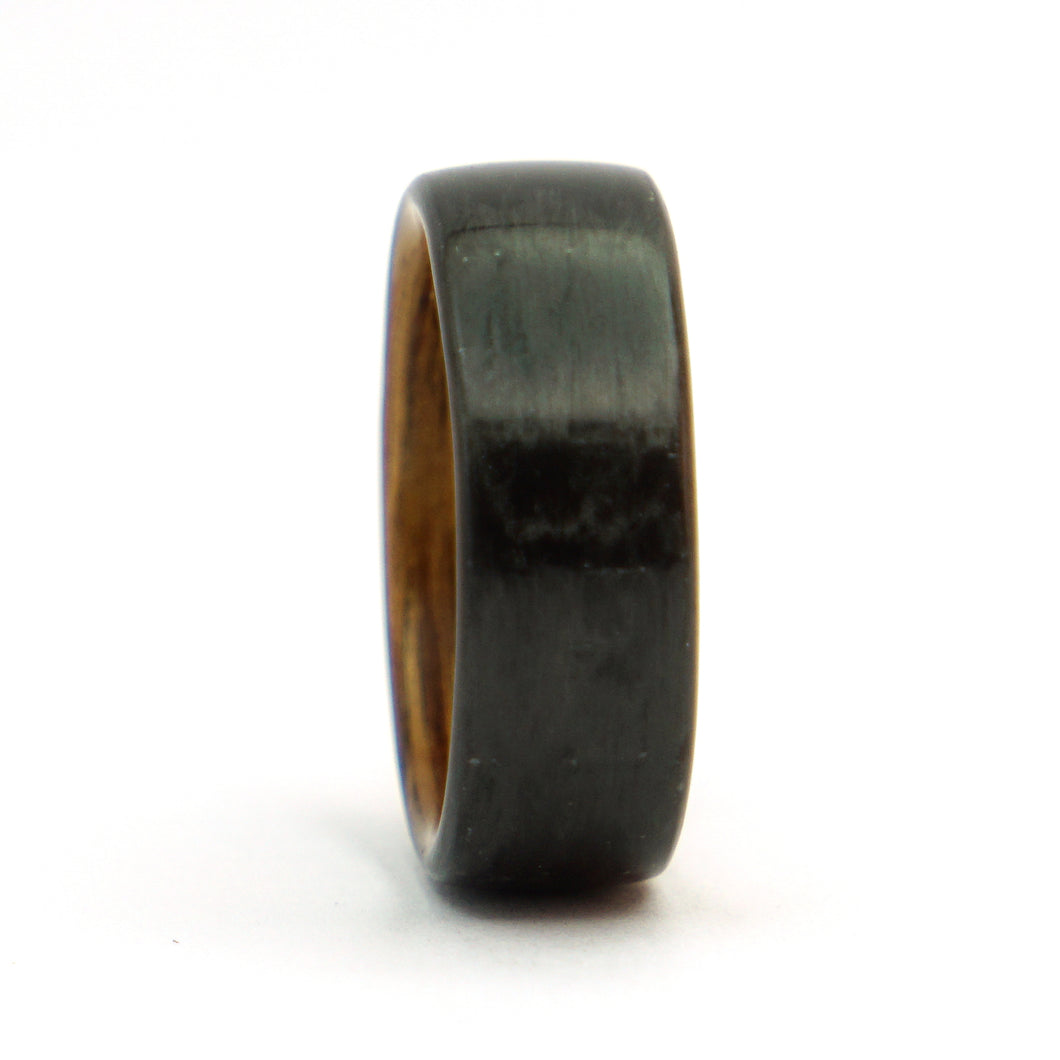 A carbon fiber and brown oak bentwood ring.