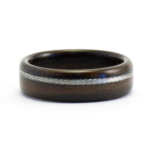 An ebony wood ring with a bicycle cable inlay.