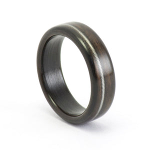 An ebony bentwood ring with a guitar string inlay.