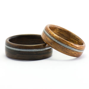 Ebony, mahogany, and bicycle cable wood rings by Ebeniste