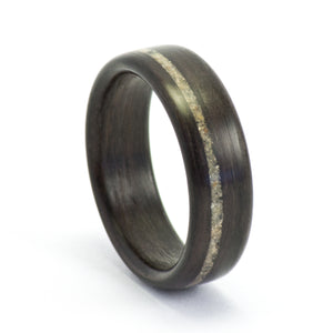 An ebony and concrete wood ring by Ebeniste