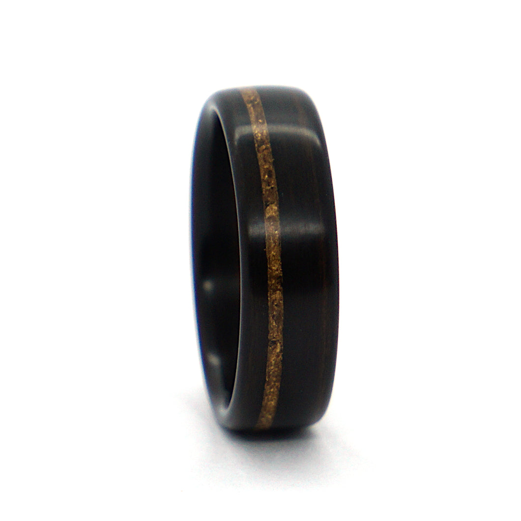 An ebony wood wedding ring inlaid with 24k gold leaf.