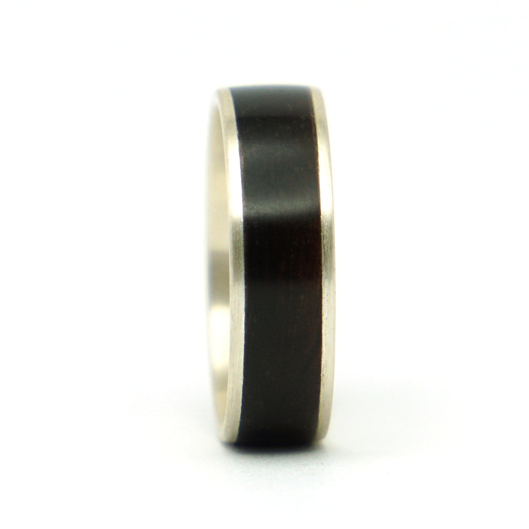 A sterling silver and bourbon barrel wood ring.