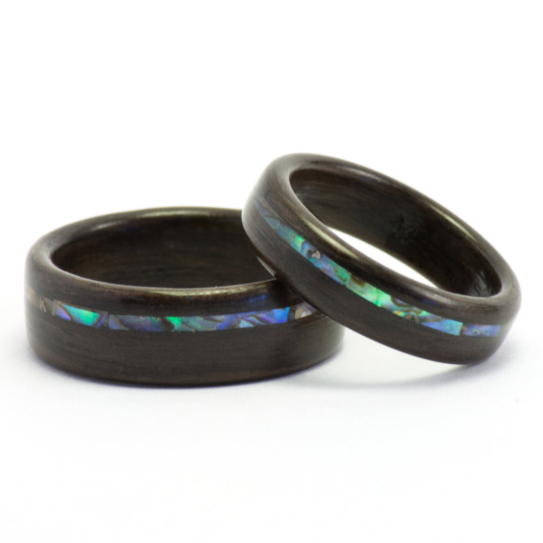 Bentwood rosewood rings with abalone inlays by Ebeniste