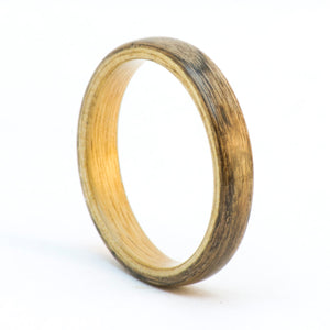 A walnut burl and aingre bentwood ring.
