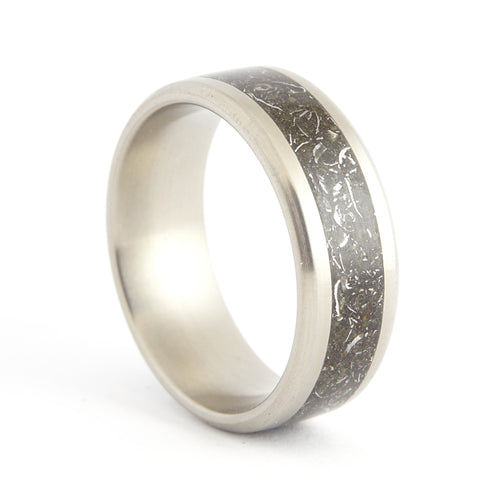 A titanium ring with an inlay of stone and iron meteorites.