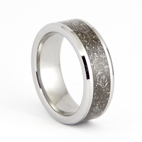 A tungsten ring with an inlay of stone and iron meteorites.