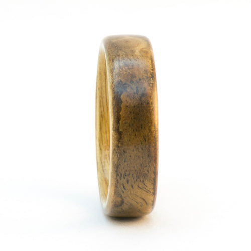 A walnut burl and anigre bentwood ring.